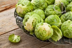 Brussels sprouts on a steamer basket