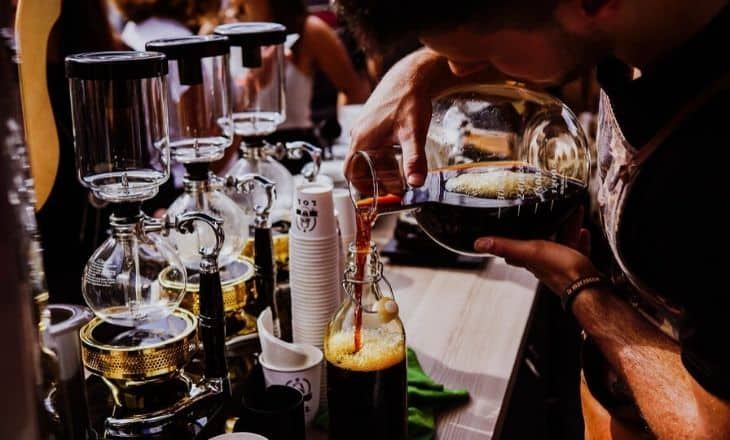 Man pouring cold brew coffee